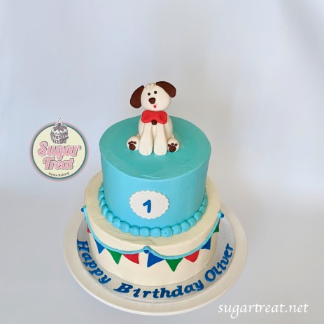 Dog and bunting first birthday
