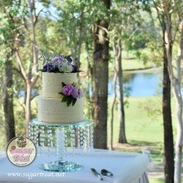 Wedding 2 tier buttercream ribbons with silk purple flowers